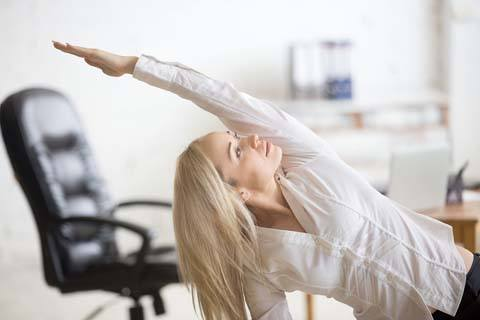 lady at Levittown business doing stretches to stay fit